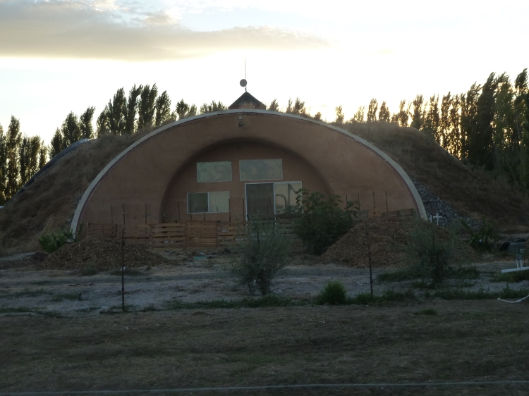 Arched bunker-tunnel-house